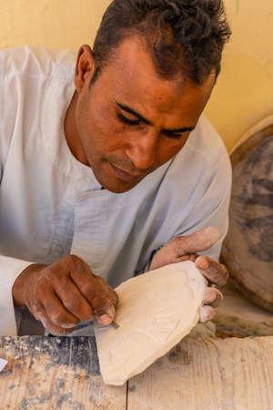 Luxor, Egypt '; October 11, 2020: Alabaster Sculptor in Luxor