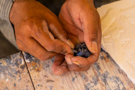 Writing in Egyptian hieroglyphic writing on a black alabaster scarab at Luxor. Egypt Banco de Imagens