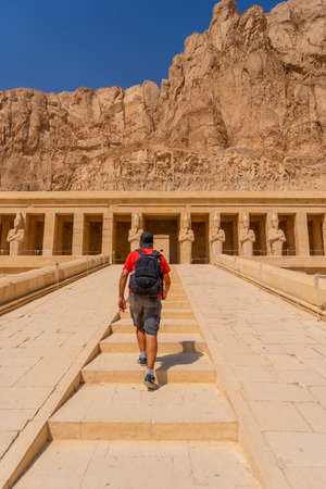 A young man climbing the stairs to Hatshepsut's Funerary Temple in Luxor. Egypt