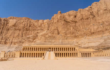 View of the Mortuary Temple of Hatshepsut without people on the way back from tourism in Luxor after the coronavirua pandemic, Egypt
