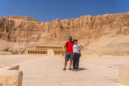 A couple at the Funerary Temple of Hatshepsut in Luxor on the return from Tourism to Egypt after the coronavirua pandemic