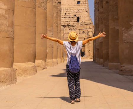 A young tourist wearing a hat visiting the Egyptian Temple of Luxor. Egypt 版權商用圖片