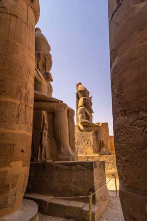 Sculptures of pharaohs in the Egyptian Temple of Luxor and its precious columns. Egypt