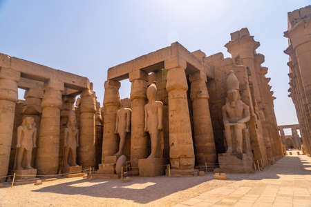 The sculptures of pharaohs and ancient Egyptian drawings on the columns of the Luxor Temple. Egypt