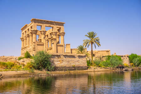 The beautiful temple of Philae and the Greco-Roman buildings seen from the Nile river, a temple dedicated to Isis, goddess of love. Aswan. Egyptian