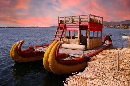 Boat used by people living on the island of Los Uros in Lake Titicaca, beautiful sunset, Peru