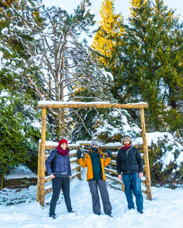 A group of friends enjoying the snowy forest in the town of Oiartzun in Peñas de Aya, Gipuzkoa. Basque Country