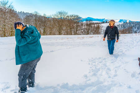 Young people enjoying the Oianleku natural park in the snow in the town of Oiartzun, next to Peñas de Aya in winter, Gipuzkoa. Basque Country Stok Fotoğraf