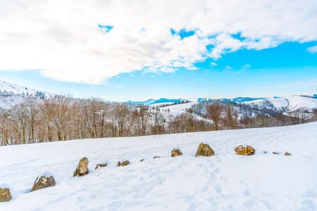 The snow-covered chromelech in the Oianleku natural park in the town of Oiartzun next to Peñas de Aya, Gipuzkoa. Basque Country Stok Fotoğraf