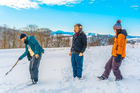 Young people enjoying the Oianleku natural park in the snow in the town of Oiartzun, next to Peñas de Aya in winter, Gipuzkoa. Basque Country