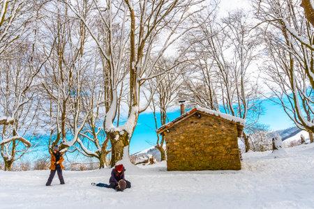 Hikers next to the beautiful refuge among giant trees in the Oianleku natural park in the town of Oiartzun along Peñas de Aya, Gipuzkoa. Basque Country
