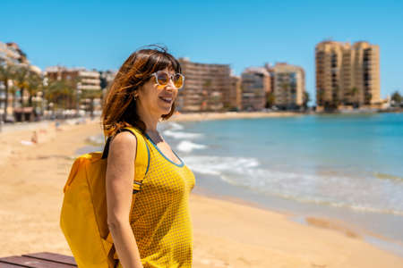 A young foreign tourist at Playa del Cura in the coastal city of Torrevieja, Alicante, Valencian Community. Spain, Mediterranean Sea