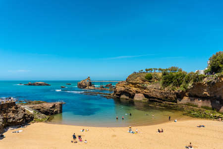 The beautiful Plage du Port Vieux on a summer afternoon where bathers can be seen bathing. Municipality of Biarritz, department of the Atlantic Pyrenees. France