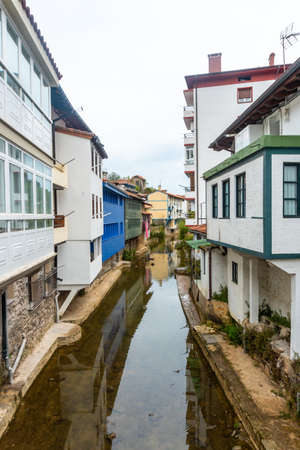 Houses on the river of the Ea municipality near Lekeitio, Bay of Biscay in Cantabria. Basque Country