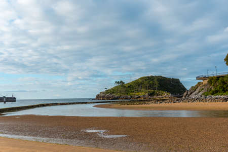 Low tide from Isuntza beach in Lekeitio next to the Island of San Nicolas, Basque country. Bay of Biscay in the Cantabrian Sea. Spain