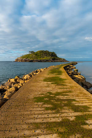 Footbridge to go to San Nicolas Island at low tide from Isuntza beach in Lekeitio, Basque Country. Bay of Biscay. Spain