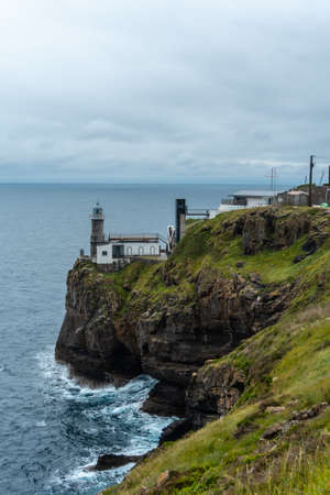 Santa Catalina de Lekeitio lighthouse and its beautiful cliffs on a cloudy spring morning, with the sea in the background, landscapes of Bizkaia. Basque Country 版權商用圖片