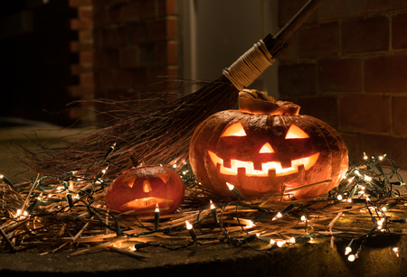 Halloween pumpkin with witches broom. Space for text. Stock Photo