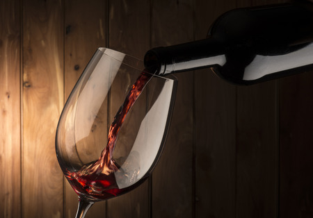 glass of red wine: glass with red wine on wooden background Stock Photo