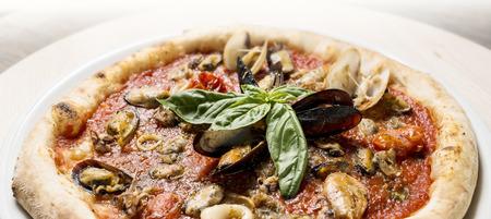 mollusc: pizza with mollusc on the dish