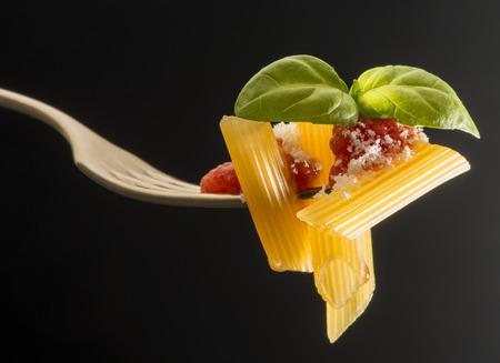 fork with macaroni and tomato sauce