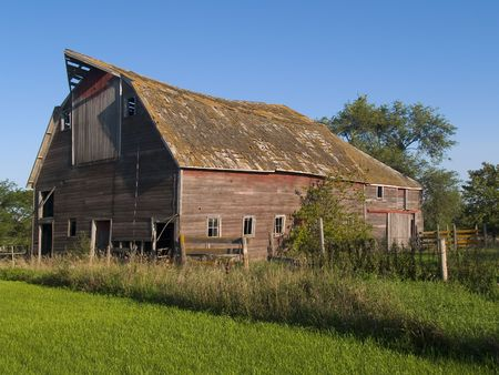 Summer Barn: A summer image of an old and rustic barn near Mitchell, South Dakota