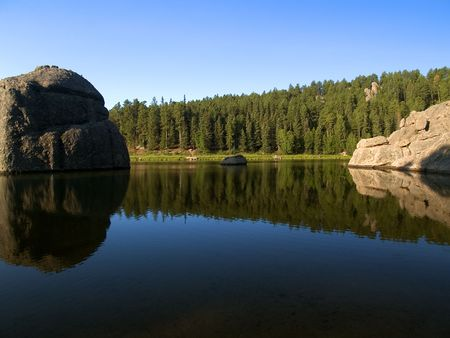 Water Between Stones: A morning view of Sylvan Lake in the Black Hills of South Dakota,