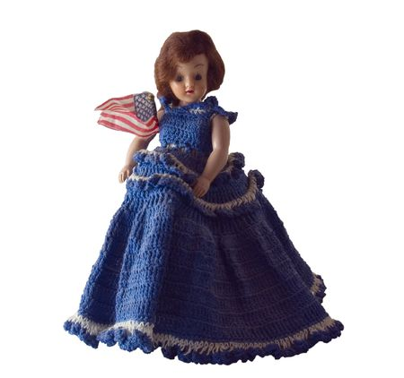 Doll with Blue Dress and an American Flag.