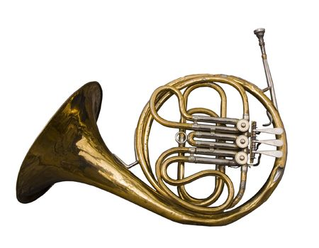 french horn: Antique dented French Horn well loved and weathered by time. Stock Photo