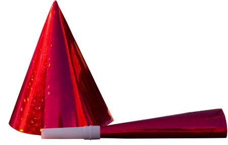 An isolated image of a red party hat and party horn, photo