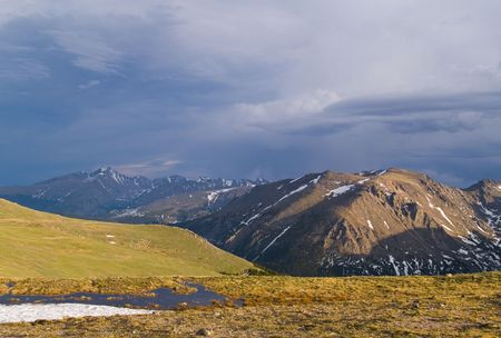 longs peak: Rain over Trail Ridge in Rocky Mountain National Park.  Stones Mtn. in the foreground and Longs Peak in the distance .. Stock Photo