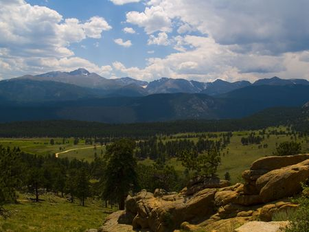 longs peak: Summer afternoon rain clouds over Longs Peak and the Front Range of the Rocky Mountains in Rocky Mountain National Park