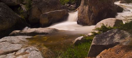 runoff: A bend in a rocky mountain river rushing with spring runoff.