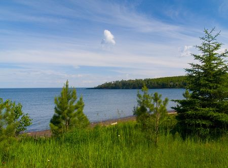 Flood Bay along the North shore of Lake Superior overlook through young evergreens. Imagens