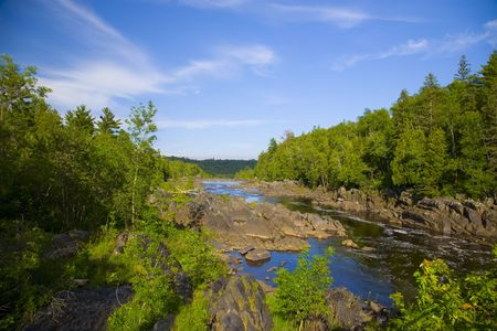 River and stone pas through the North Woods of Minnesota.