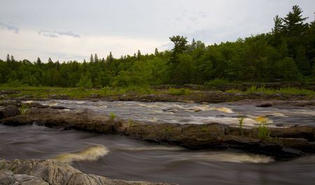 A River rushes through stone channels in the North Woods of Minnesota.