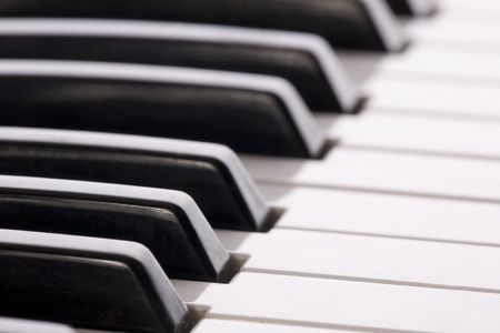 Keyboard extending to the horizon on a close up image of a synthesizer.