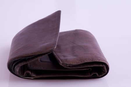 A close up image of an old leather wallet.
