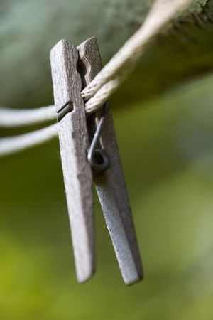 A clothes pin on a clothes line in a close up macro image.
