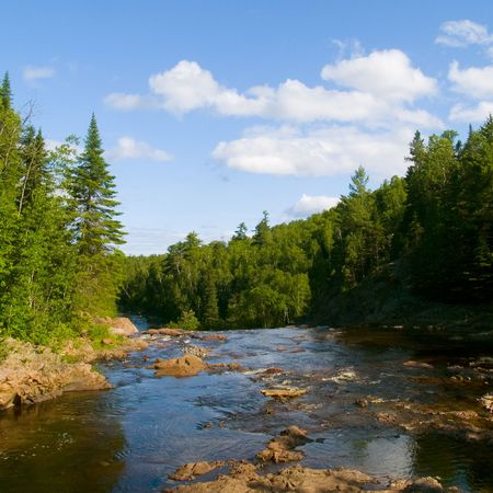 Over the high falls of the Baptism river in Northern Minnesota. Imagens