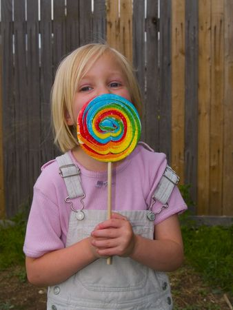 Girl with a giant lollipop as big as her head Stock Photo - 3396322
