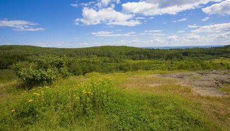overlook: The vast forest landscape of the North woods of Minnesota overlooking Lake Superior in the distance.