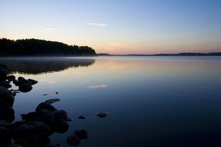 north woods: A blue misty lake at dawn in the North Woods of Minnesota Stock Photo