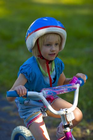 A girl on a bike ride concentrating hard on her balance and having fun. Stock Photo - 3476910