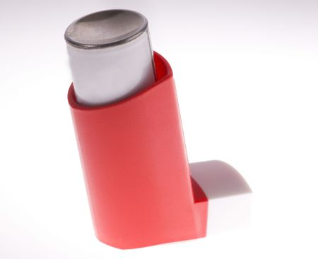 A red asthma inhaler isolated on a white background Stok Fotoğraf