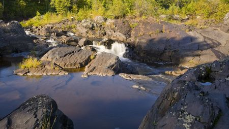 Calm above falls into the raging St. Louis river in Northern Minnesota Stock Photo - 3584897