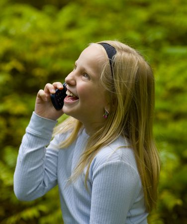 A happy girl on a cell phone outdoors Stock Photo - 3633005