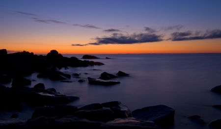 Lake Superior and stones before dawn at Brighton beach in Duluth Minnesota photo