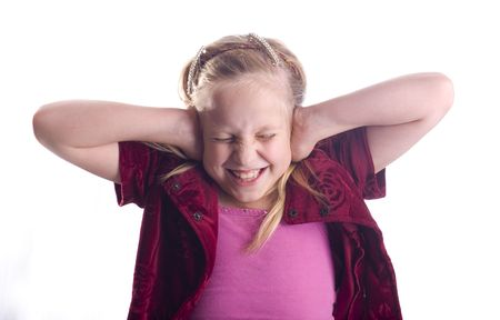 loud: Girl covering her ears because it is too loud isolated on white