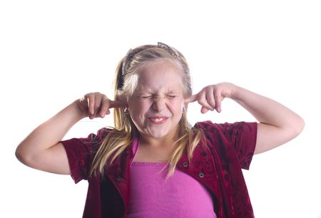 Girl plugging her ears and closing her eyes.